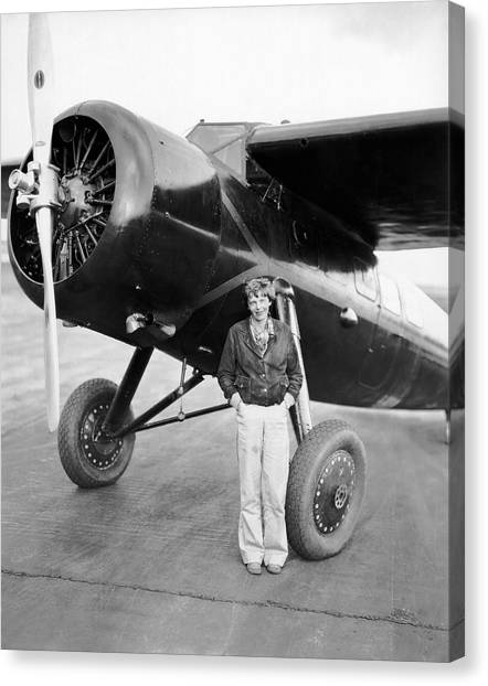Aviators Canvas Print - Amelia Earhart And Her Plane by Underwood Archives