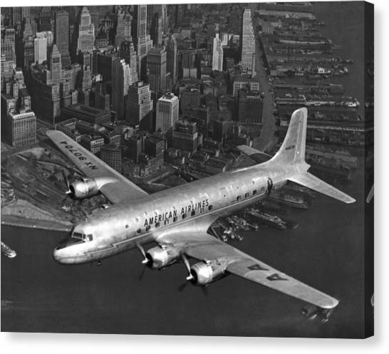 American Dc-6 Flying Over Nyc Canvas Print