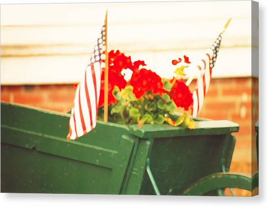 American Flags And Geraniums In A Wheelbarrow In Maine, Two Canvas Print