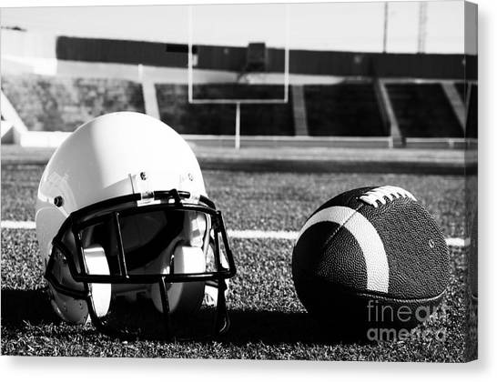 American Football And Helmet On Field Canvas Print