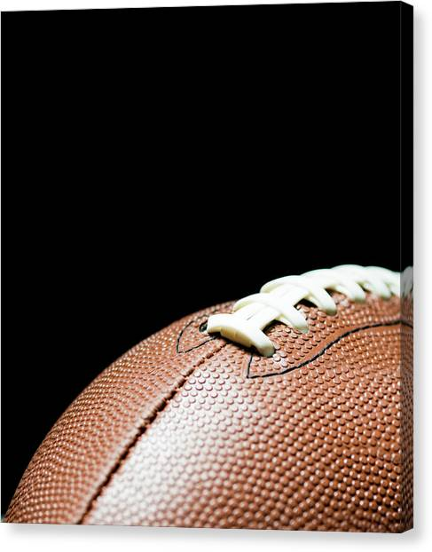 American Football On Black Background Canvas Print by By nicholas