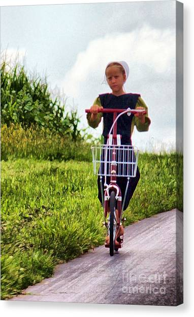 Amish Girl Scooting In Lancaster Pennsylvania Usa Canvas Print