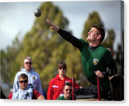 Royal Marines Canvas Print - Amputee Shot Put Athlete by Us Air Force/mark Fayloga
