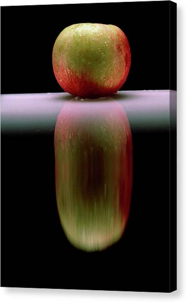 An Apple & Its Reflection In A Polished Table Top Canvas Print by Mike Devlin/science Photo Library