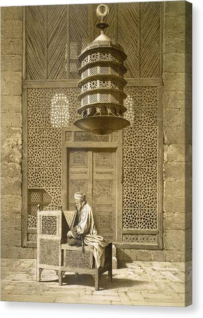 Muslim Canvas Print - An Imam Reading The Koran In The Mosque by Maurice Keating