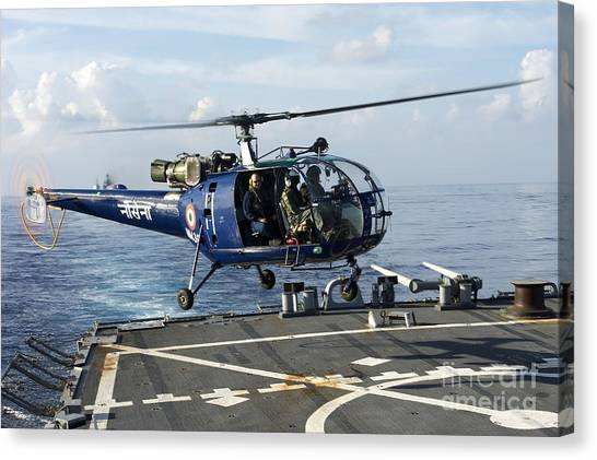 John Mccain Canvas Print - An Indian Navy Helicopter  Lands by Stocktrek Images