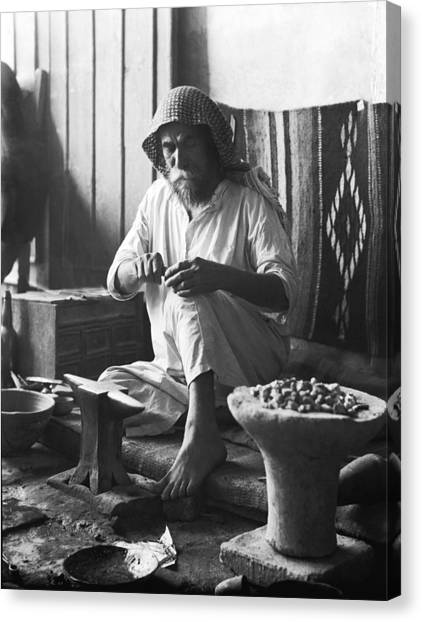 Baghdad Canvas Print - An Iraqi Silversmith At Work by Underwood Archives