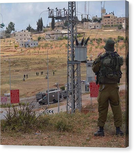 Israeli Canvas Print - An #israeli Soldier Watches Over The by Martin Rix