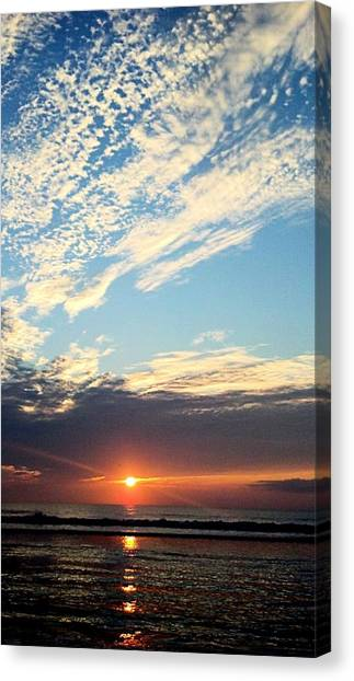 An Ocean And A Sunrise Canvas Print