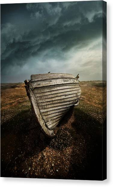 An Old Wreck On The Field. Dramatic Sky In The Background Canvas Print