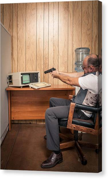 Angry Office Working Aiming Gun At Old Computer Canvas Print by Sjharmon
