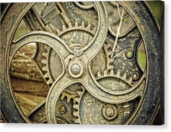 Antique Mangle Wheel Canvas Print by Lesley Rigg