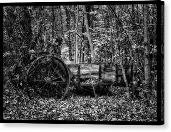 New Hampshire Canvas Print - Antique Manure Spreader In The Forest by Jeff Sinon