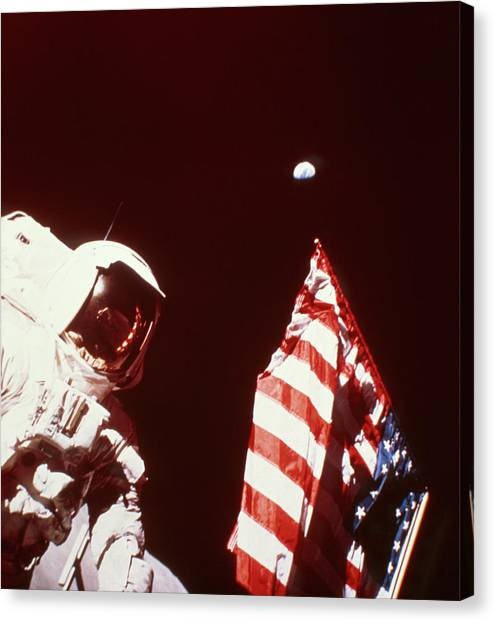 Space Suit Canvas Print - Apollo 17 Astronaut On Moon With Flag by Nasa/science Photo Library.