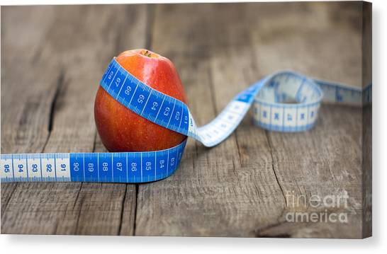Weights Canvas Print - Apple And Measuring Tape by Aged Pixel