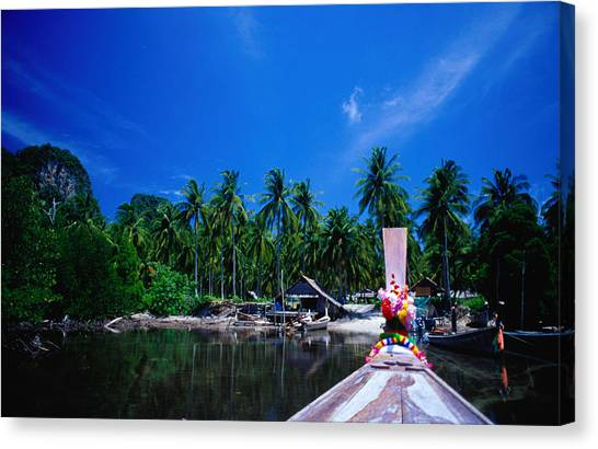 Approaching Ao Bakao By Longboat On The Canvas Print by Karen Trist