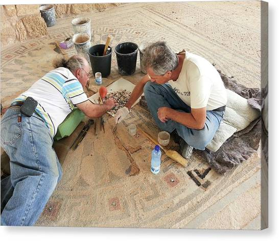 Archaeologists Canvas Print - Archeologists Restore A Mosaic Floor by Photostock-israel