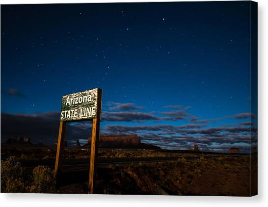 Arizona State Line In Monument Valley At Night Canvas Print