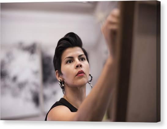 Artist Painting In Her Studio Canvas Print by Scott Zdon