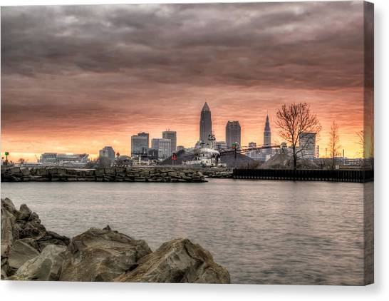As Morning Breaks From The Breakwall Canvas Print