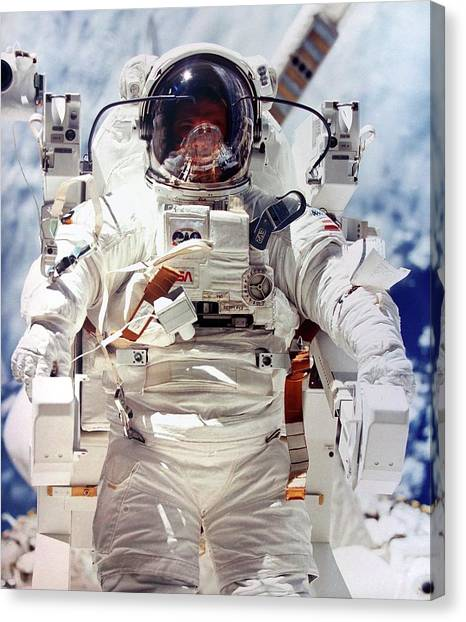 Space Suit Canvas Print - Astronaut During Space-walk by Detlev Van Ravenswaay