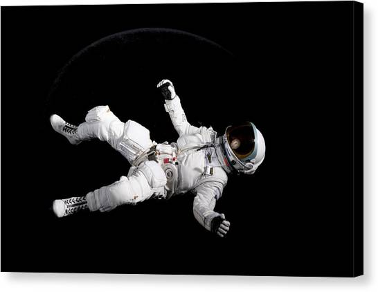 Astronaut Floating Canvas Print by Rick Partington / EyeEm