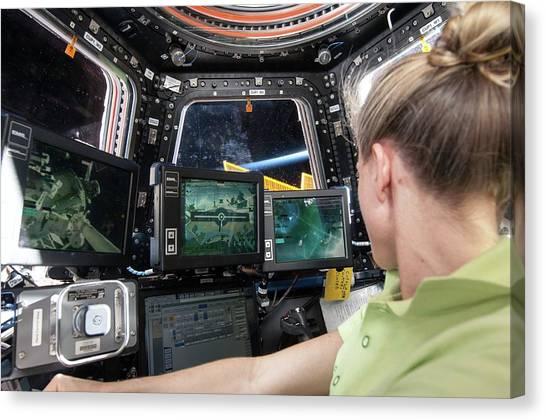 Astronauts Canvas Print - Astronaut In Iss Robotics Workstation by Nasa