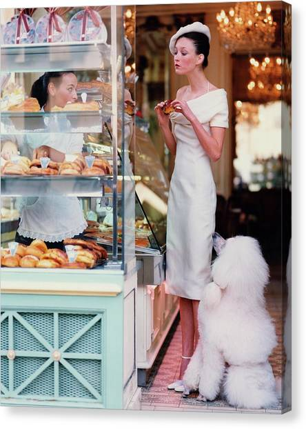 Indoors Canvas Print - Audrey Marnay At A Patisserie With A Poodle by Arthur Elgort