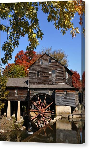 Autumn Day At The Old Mill Canvas Print by John Saunders