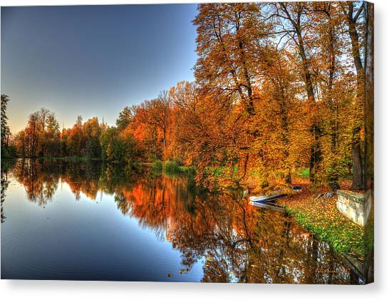 Autumn Trees Over A Pond In Arkadia Park In Poland Canvas Print