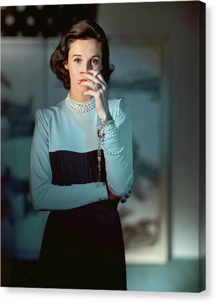 Cigarette Canvas Print - Babe Paley Wearing A Traina-norell Dress by Horst P. Horst