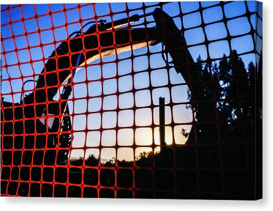Backhoes Canvas Print - Backhoe At Construction Site Seen by Ron Koeberer