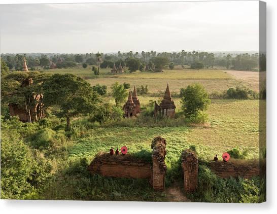 Bagan, Buddhist Monks Sitting Amongst Canvas Print