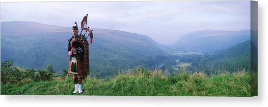 Bagpipes Canvas Print - Bagpiper At Loch Broom In Scottish by Panoramic Images