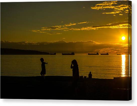 Balancing Into The Sunset Canvas Print