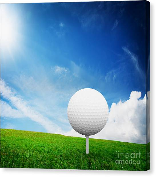 Golf Course Canvas Print - Ball On Tee On Green Golf Field by Michal Bednarek