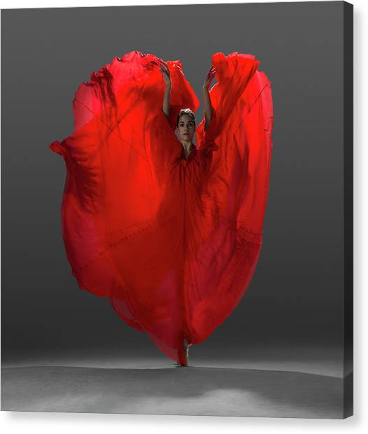 Ballerina On Pointe With Red Dress Canvas Print by Nisian Hughes