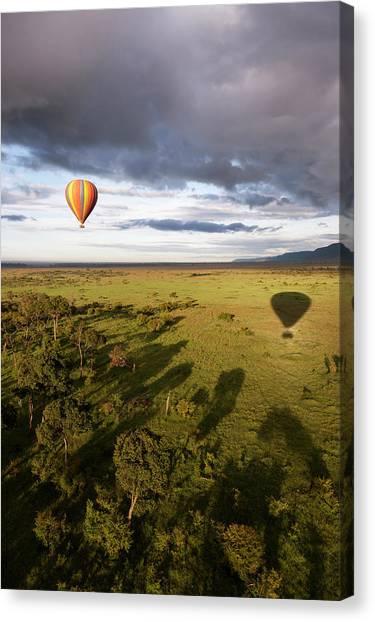 Balloon In Masai Mara National Park Canvas Print by Luis Davilla