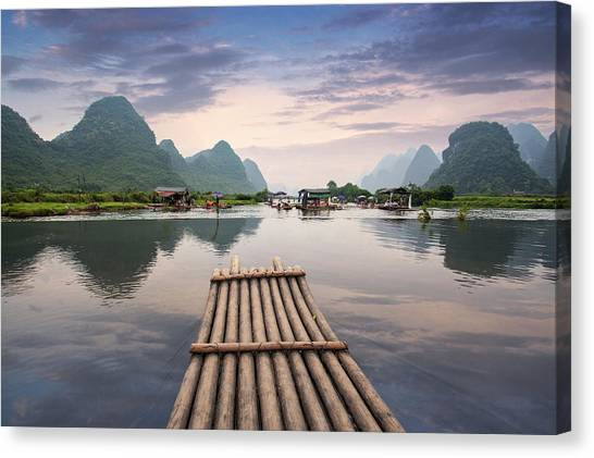 Bamboo Raft On Yulong River Canvas Print