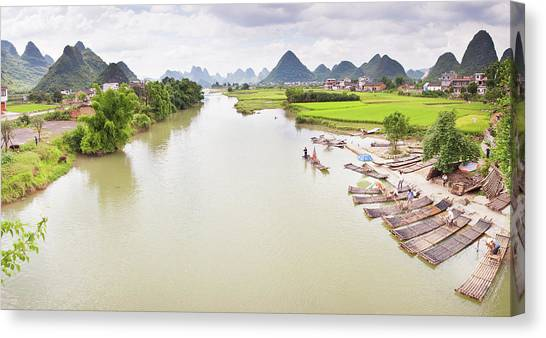 Bamboo Rafts On Banks Of Yulong River Canvas Print