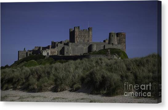 Fortification Canvas Print - Bamburgh Castle by Nigel Jones