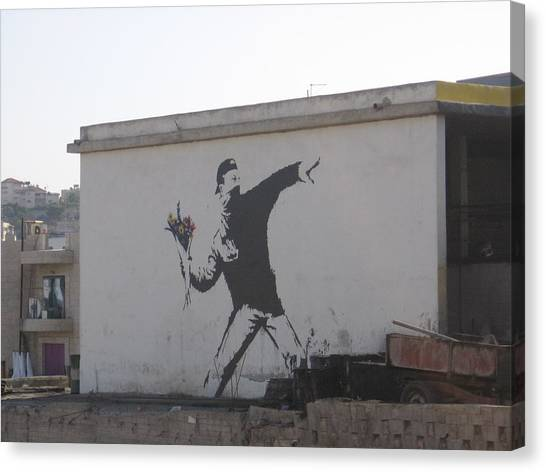 Palestinian Canvas Print - Banksy Flower Thrower In East Jerusalem by Arik Bennado