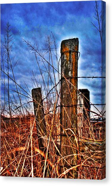 Canvas Print featuring the photograph Barb Wire Fences by William Havle