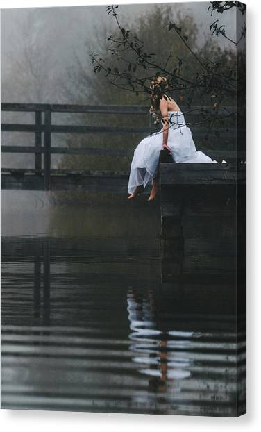 Barefoot Bride In White Wedding Dress Sitting On A Jetty At A La Canvas Print by Leander Nardin