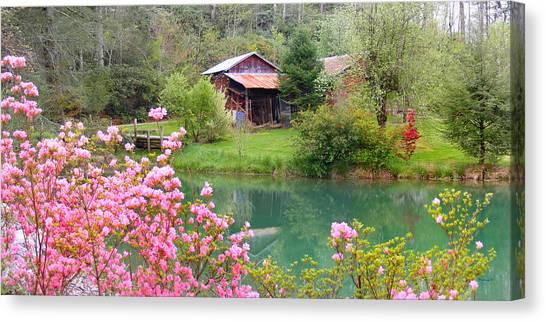 Barn And Flowers Near Pond Canvas Print
