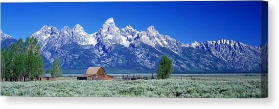 Wy Canvas Print - Barn On Plain Before Mountains, Grand by Panoramic Images