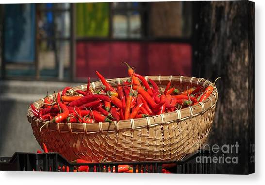 Basket With Red Chili Peppers Canvas Print