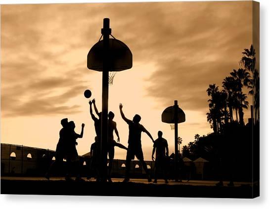 Basketball Players At Sunset Canvas Print