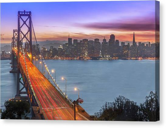 Bay Bridge And San Francisco Skyline At Canvas Print by Spondylolithesis
