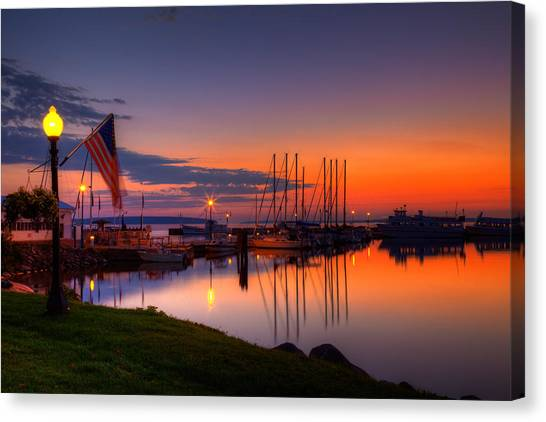 Bayfield Wisconsin Fire In The Sky Over The Harbor Canvas Print
